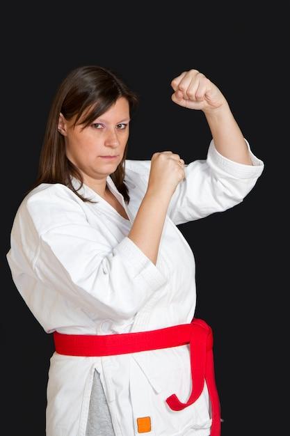Girl in kimono doing karate Premium Photo