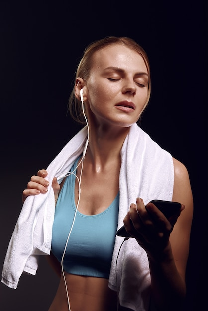 Girl listens to music after training Premium Photo