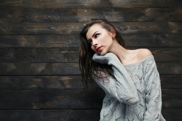 Girl in a long-sleeved sweater Free Photo