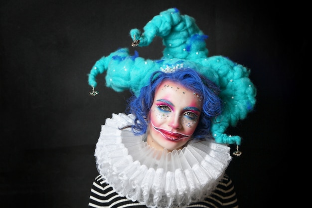 Girl in makeup and costume jester Premium Photo