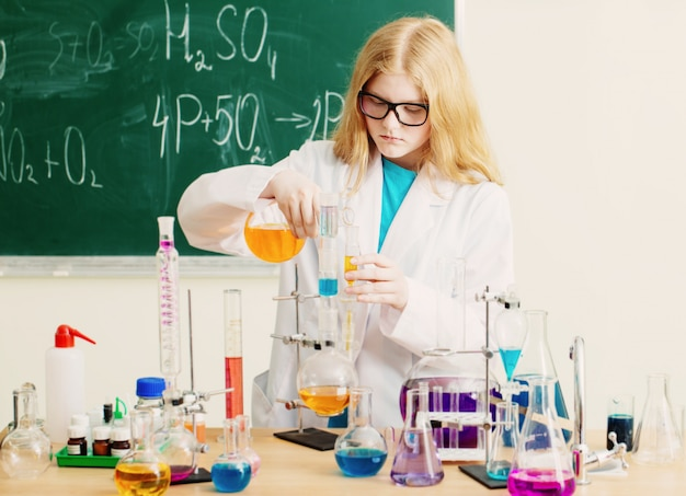 Premium Photo | Girl making a chemical experiment in a chemistry lab