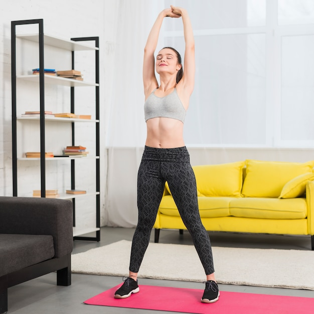 Girl making exercise in her house Free Photo