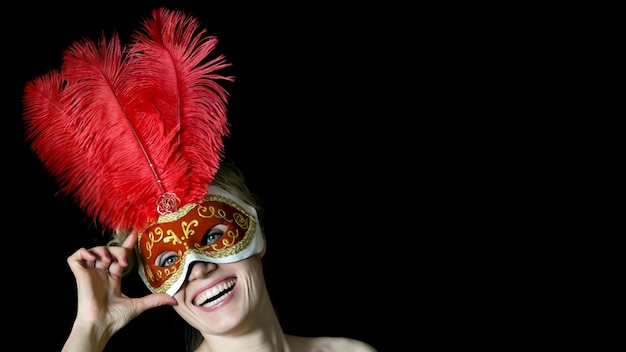 Girl in mask with feathers at the carnival. Premium Photo