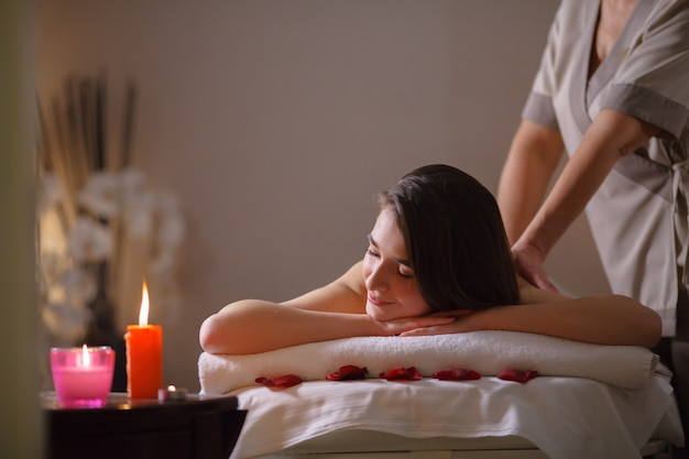 Girl on massage in the spa salon. | Premium Photo