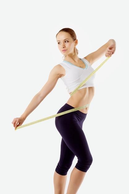 女の子は腰を測定 Premium写真