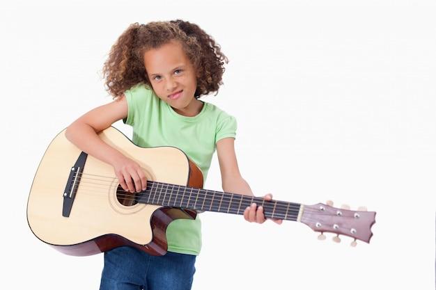 Girl playing the guitar Premium Photo