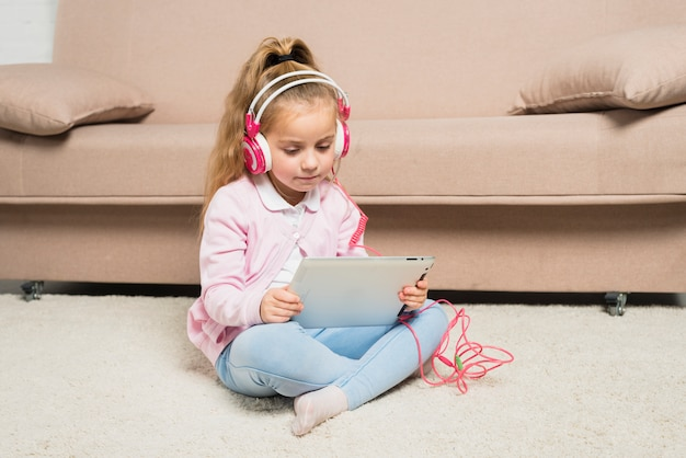 Girl playing with tablet Free Photo