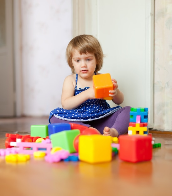 girl plays with toys in home Free Photo