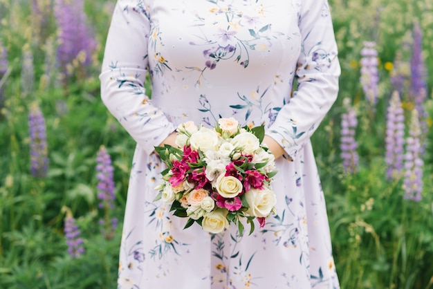 Girl plus size is holding a bouquet of flowers Premium Photo