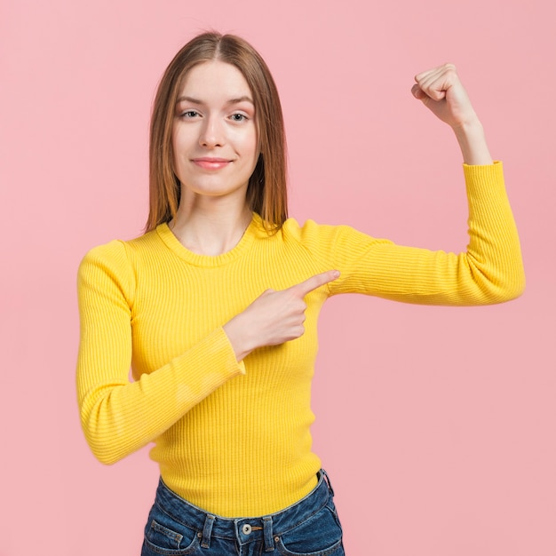 Girl pointing at her arm Free Photo