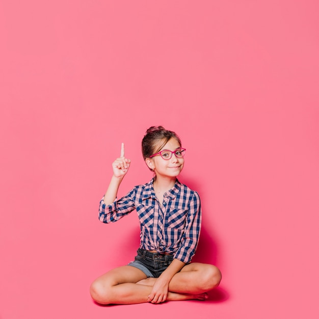 Girl pointing up Free Photo