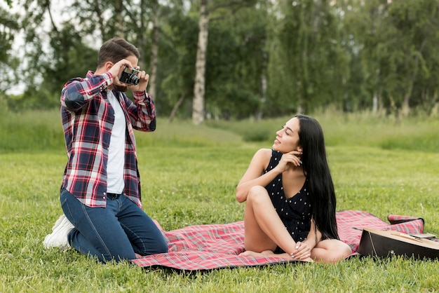 Girl posing on a picnic blanket Free Photo