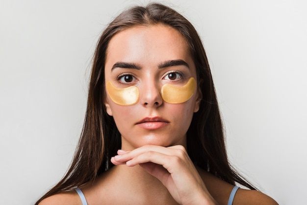 Girl posing with face mask Free Photo