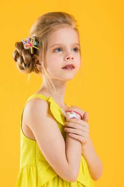 Girl posing on yellow background. Premium Photo