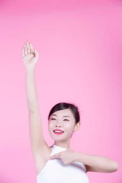 Girl raised armpit up. Free Photo