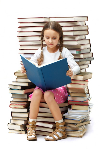 Girl reading alone Free Photo