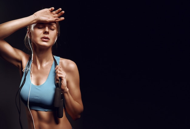 Girl resting after exercises in the gym Premium Photo