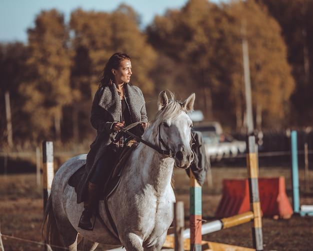 Girl ride a horse Free Photo