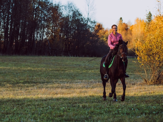 Girl ride a horse Free Photo