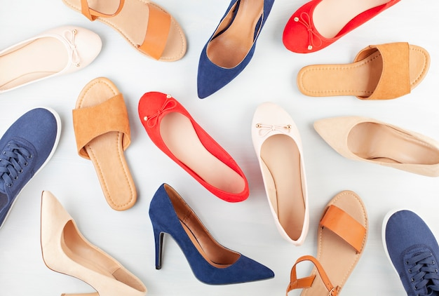 Girl's spring summer shoes collection. mock up of different styles and colos shoes. Premium Photo