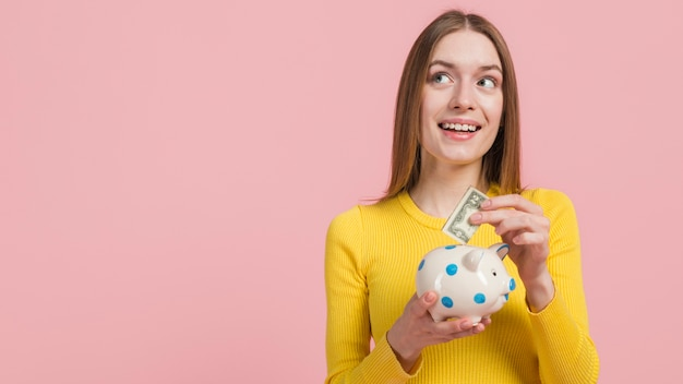 Girl saving money Free Photo