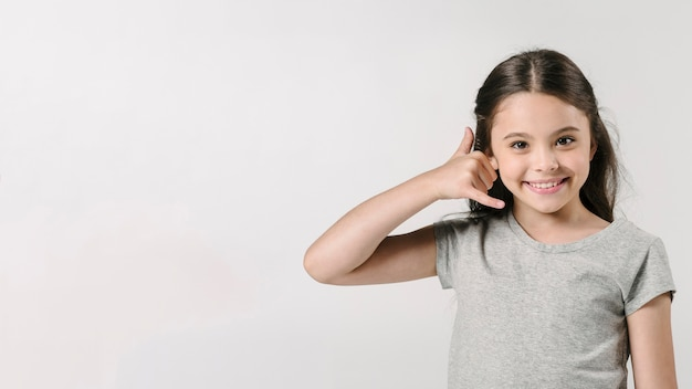 Girl showing call sign in studio Free Photo