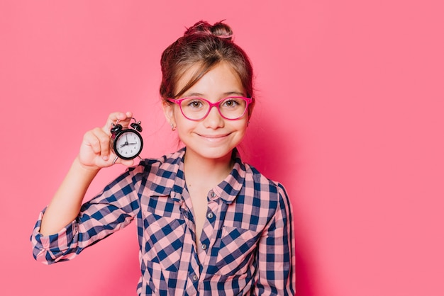 Girl showing clock Free Photo