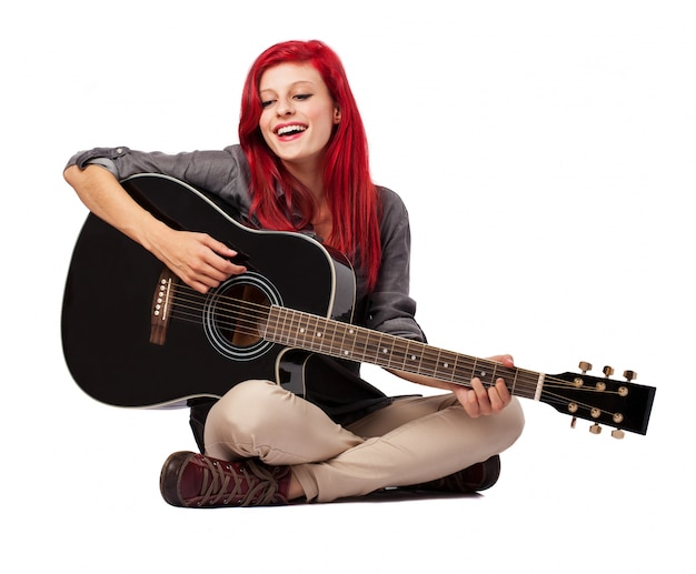 Girl Sitting On The Floor And Playing Her Guitar Photo Free Download