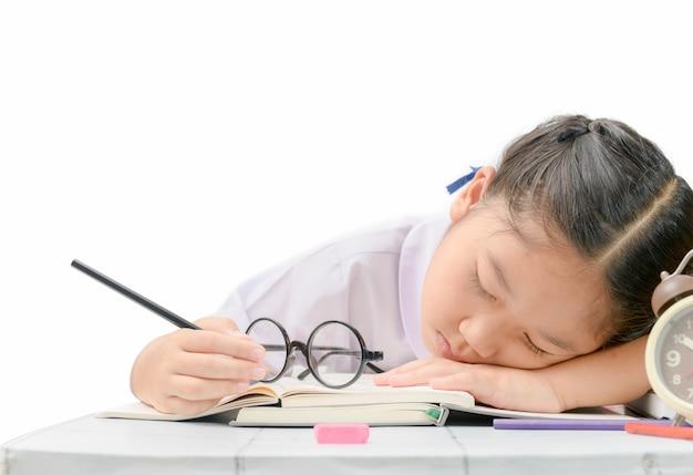 Girl sleep while doing hard homework isolated Premium Photo
