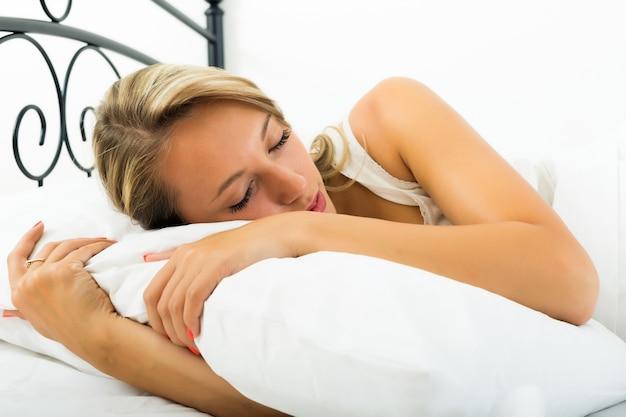 Girl sleeping with white pillow Free Photo
