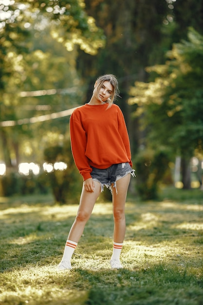 Girl standing in a summer park Free Photo