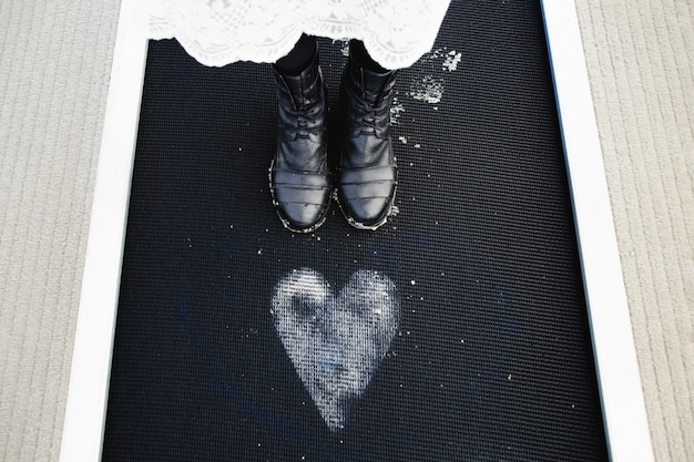 The girl stands near the painted heart on the floor Free Photo