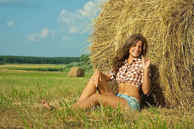 Girl  on straw bale Free Photo