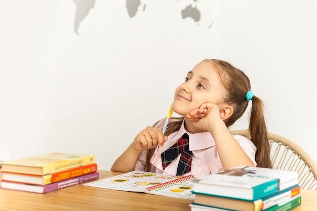 Girl studing at table on white background Premium Photo