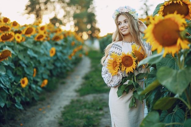 Girl and sunflowers Free Photo