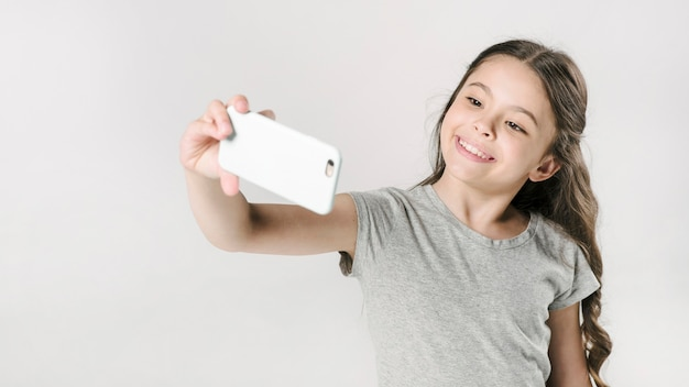 Girl taking selfie in studio Free Photo