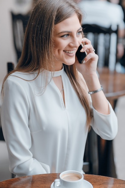 Free Photo | Girl talking on the phone while smiling