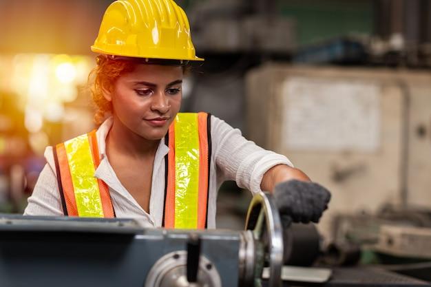 Premium Photo | Girl teen worker african american working labor in industry  factory with heavy steel machine.