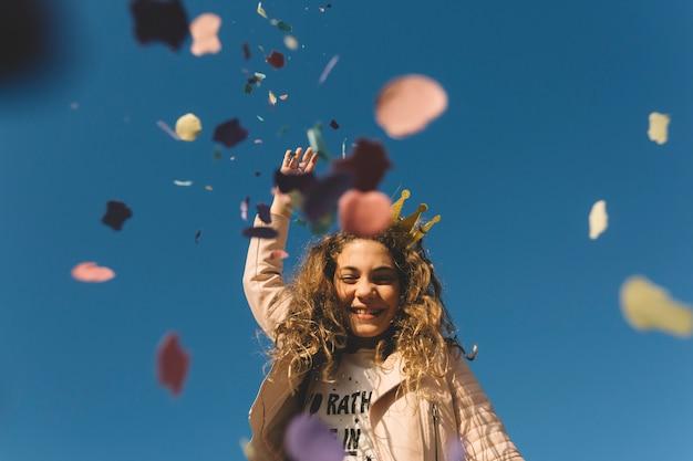 Girl throwing confetti Free Photo