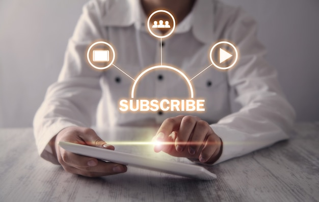 Girl using digital tablet. subscribe concept Premium Photo