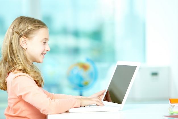 Girl using the laptop in class Free Photo