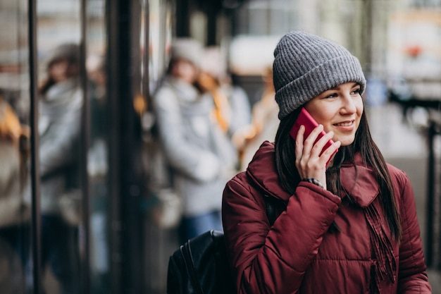 Girl using phone outside the street and meeting with friends Free Photo