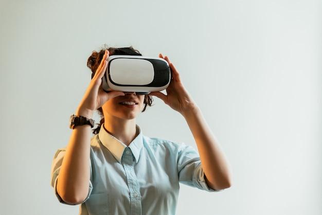 Girl using vr glasses in the office Premium Photo