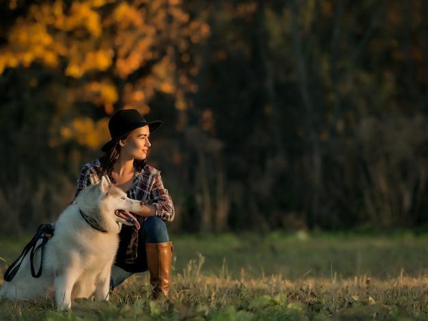Girl walks with husky Free Photo