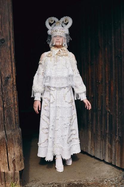 Girl in white ethnic russian dress Premium Photo