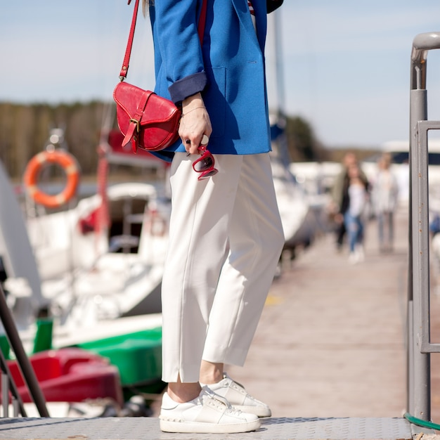 Girl in white trousers and a blue jacket Premium Photo