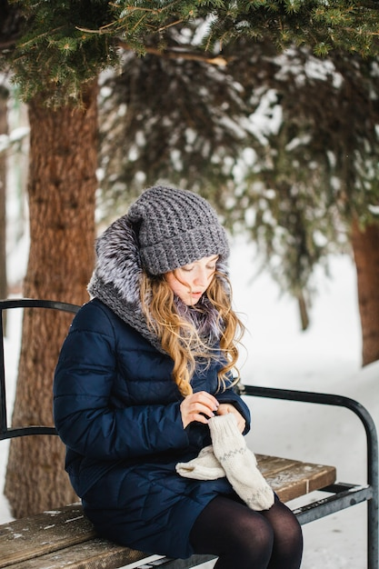 Girl in winter park covered of snow Premium Photo