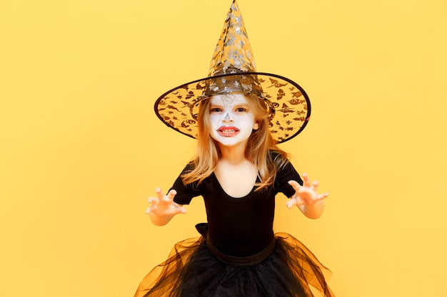 Girl in witch halloween costume Premium Photo