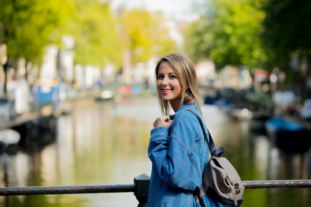Girl with backpack in amsterdam Premium Photo