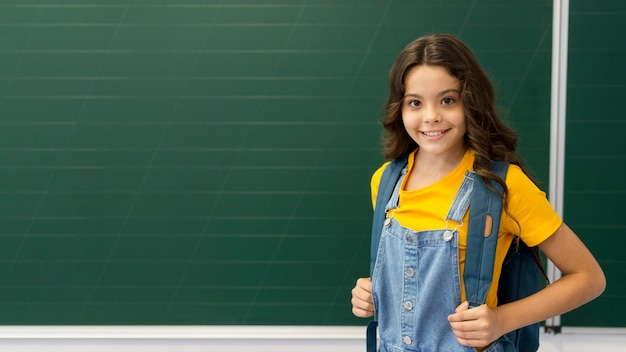 Girl with backpack in class Premium Photo